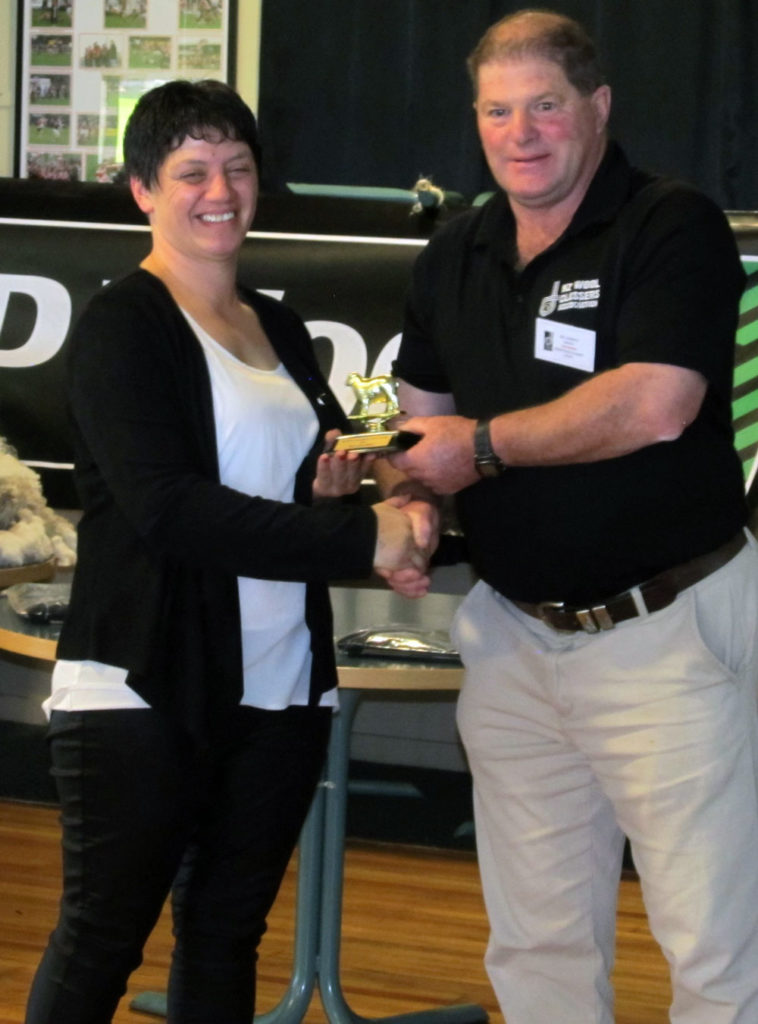 Tina Elders being presented with Yield Award from Bill Dowle
